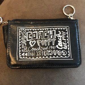 """Coach brand. Black """"Poppy"""" clutch, wristlet."""